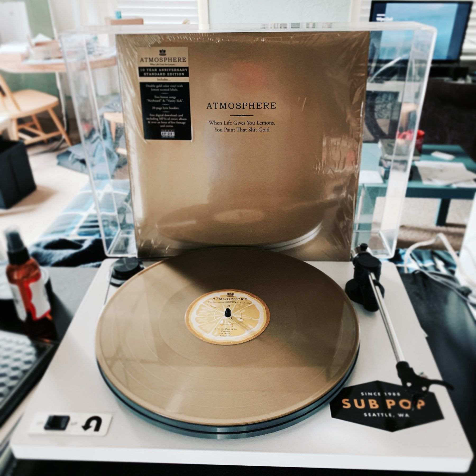 Gold Vinyl album by Atmosphere on a white turntable